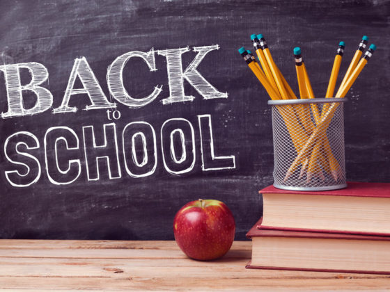 43530272 - back to school lettering with books, pencils and apple over chalkboard background